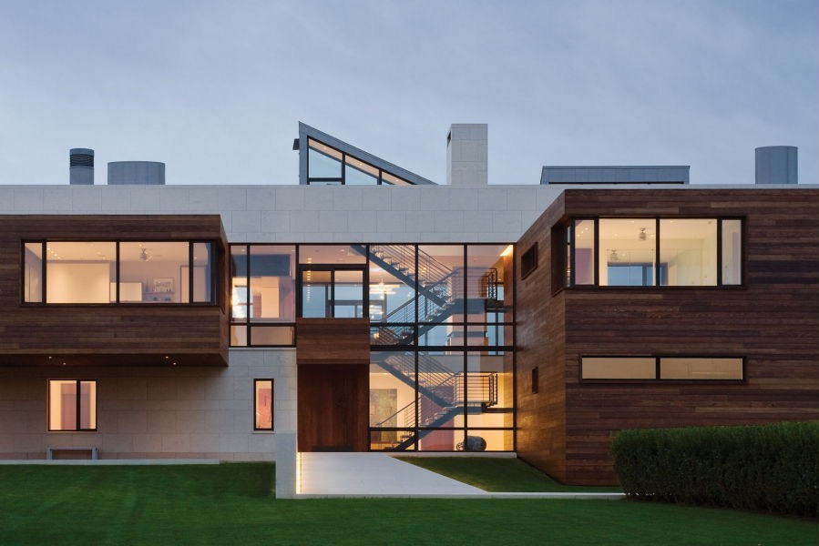 Modern home with windows looking into the beat of the home