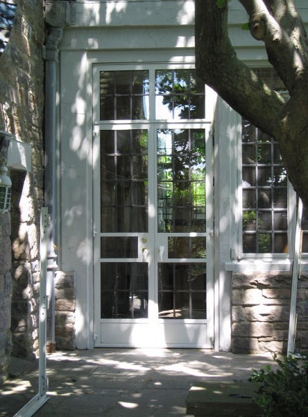 Secret white wooden window door in garden