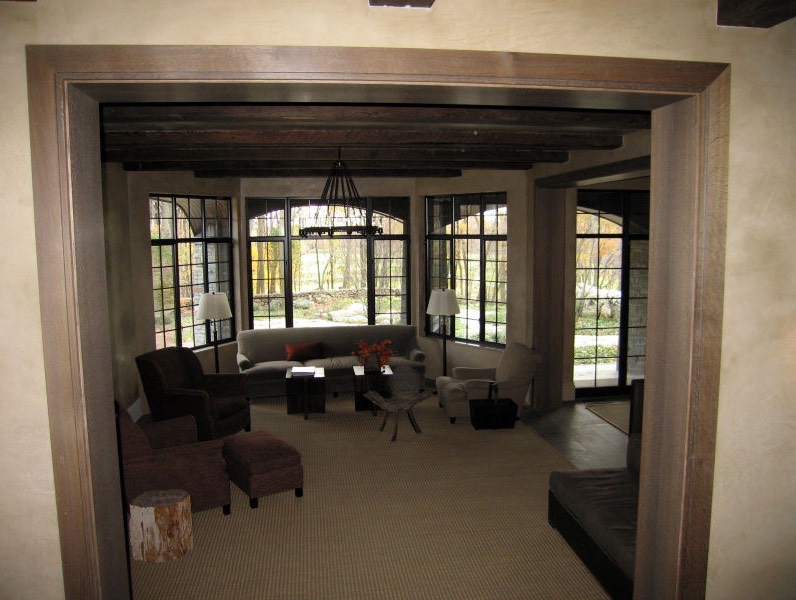 Living room in beautiful home with large windows
